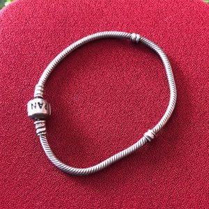 Pandora 7 1/2 inch long Sterling silver bracelet.